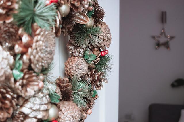 Wooden Christmas wreath on a door
