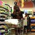 When Tradition Meets The Modern World... African Tribeswoman Pictured In A Supermarket