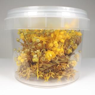 Bote flores amarillas