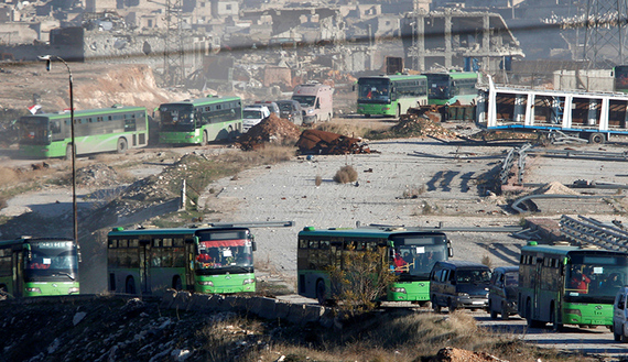 Turkey upbeat, nervous as first civilian convoy evacuates Aleppo