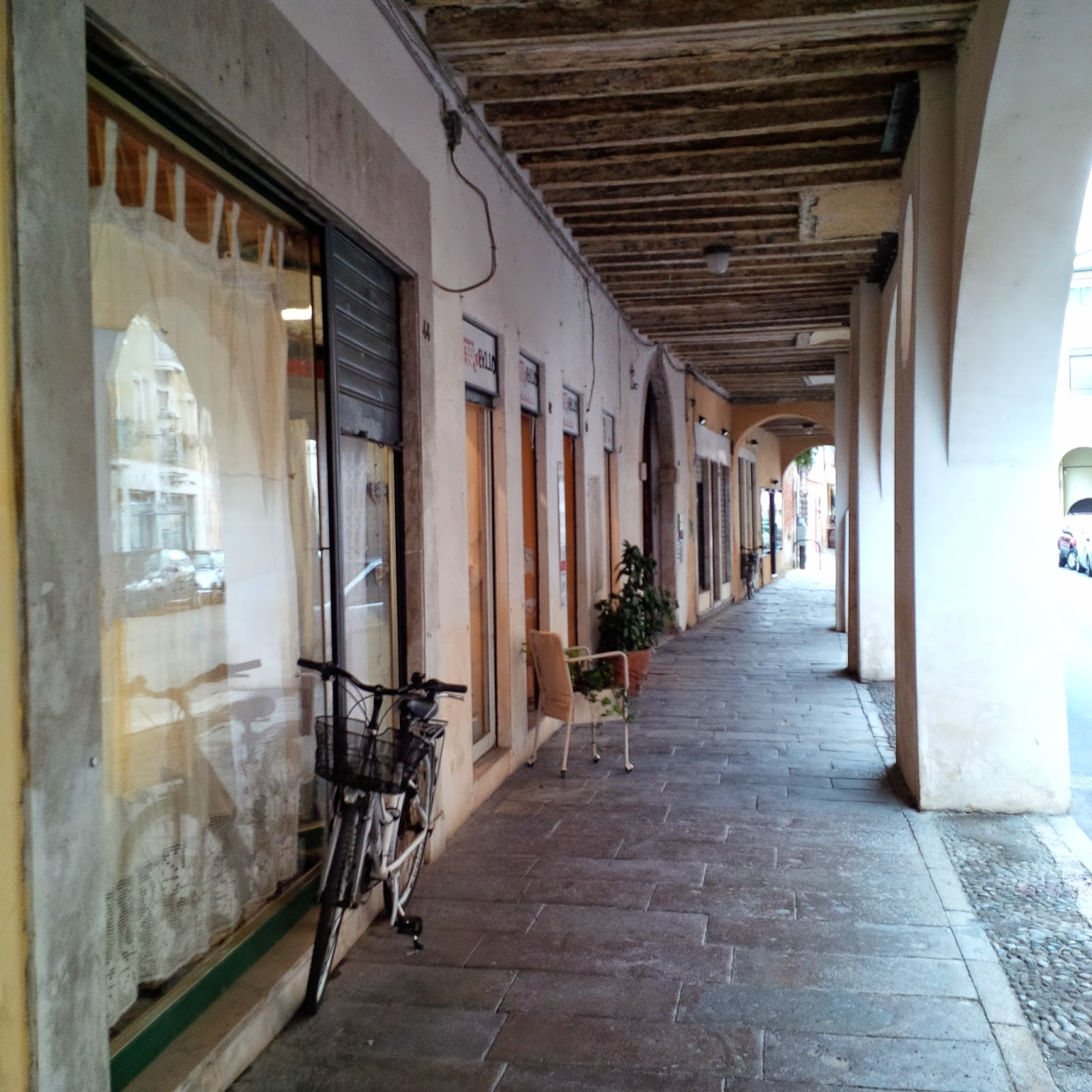 An elegant arcade with old-fashioned shops in Vicenza