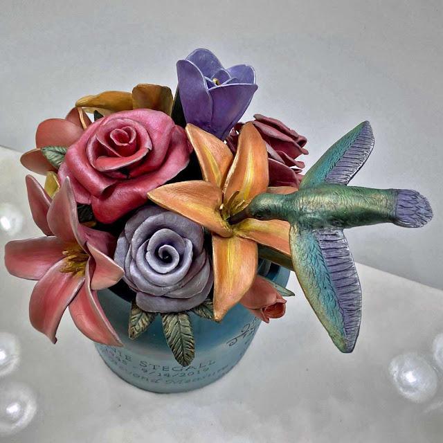 mixed bouquet, hummingbird urn sculpture