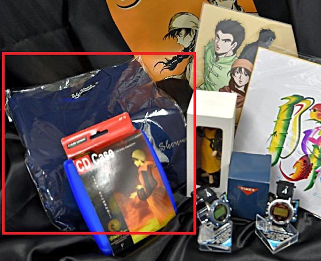 Shenmue Logo on Blue Shirt (From Kickstarter Rewards image, at left)
