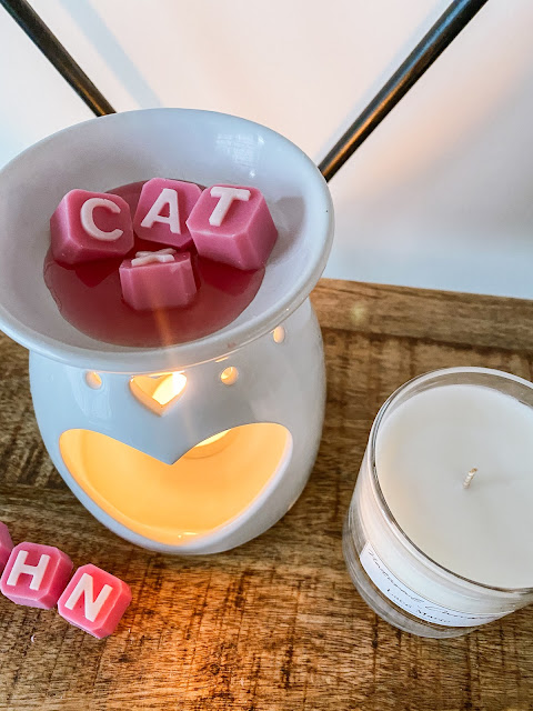 Pink personalised wax melts melting in a wax melter