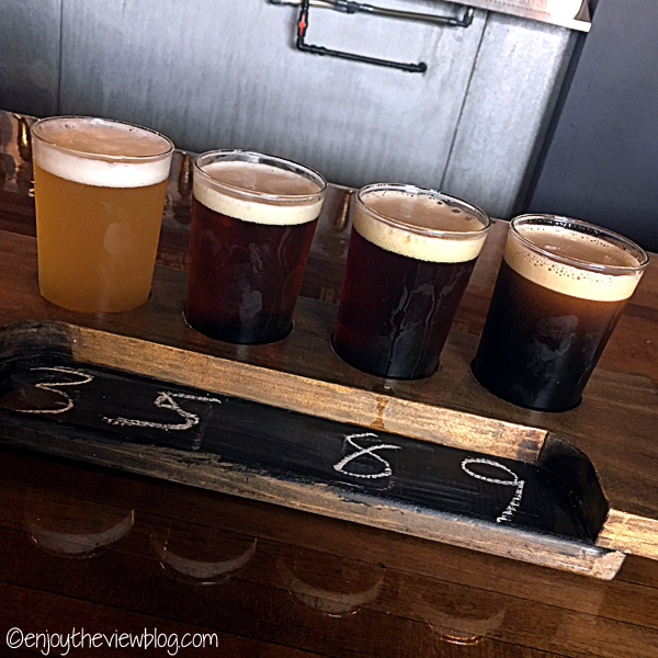 four numbered glasses of beer