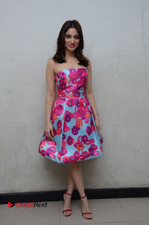 Actress Tamanna Latest Images in Floral Short Dress at Okkadochadu Movie Promotions  0174.JPG