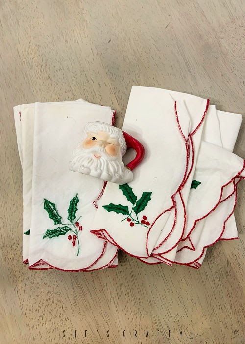 thrift store purchases- Christmas napkins, Santa candle holder