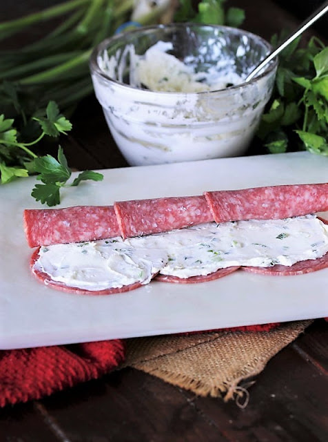 Rolling Up Salami to Make Salami Cream Cheese Roll-Ups Image