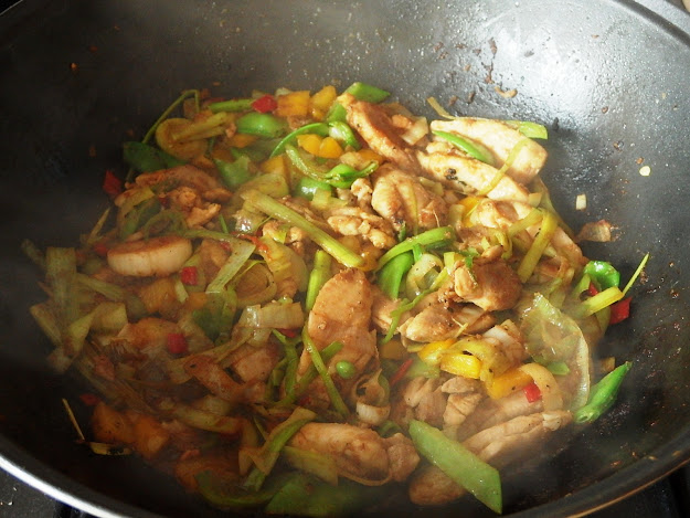 Chicken and leek stir fry with peppers and mange tout