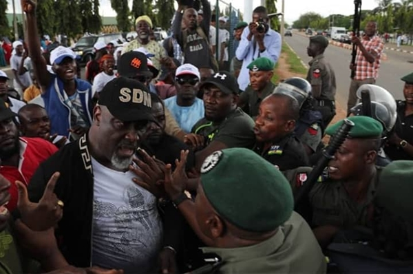Dino Melaye shares photos of the moment a police commissioner punched him