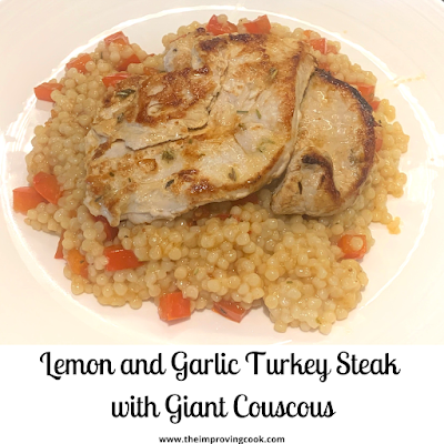 Lemon and Garlic turkey steaks with couscous on a white plate