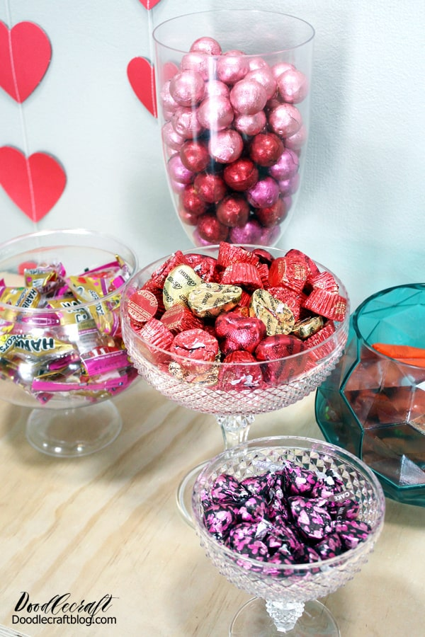Pedestal containers, vases and jars filled with yummy candy for Galentine's day. Candy Buffet's are a must at any party!