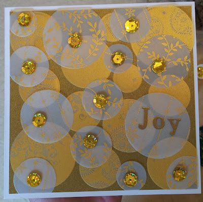 Christmas Card with white and gold vellum circles and sequins