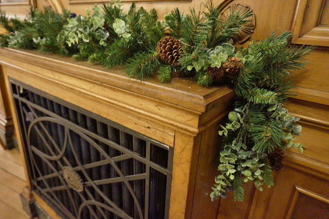 Garland on wooden mantle piece