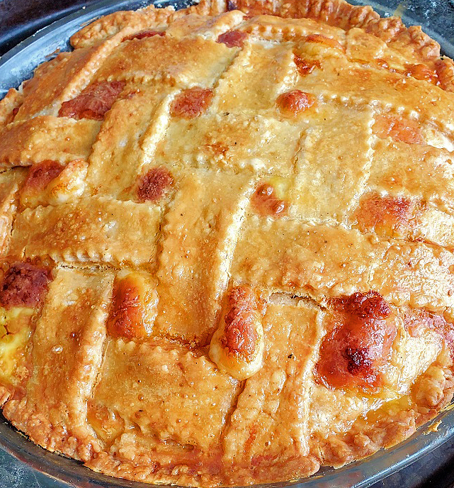 this is an Easter Italian Meat pie stuffed with many deli meats like pepperoni, capicola and salami loaded with ricotta and lots of other cheese