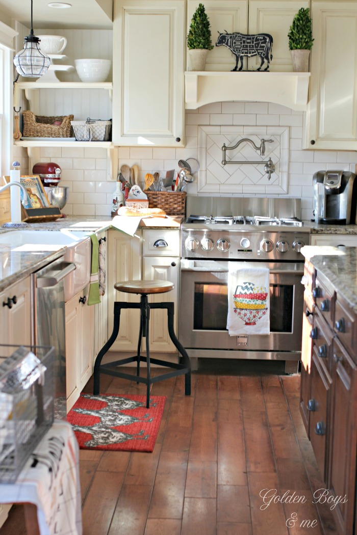 DIY farmhouse style kitchen with mantel hood , subway tile backsplash, open shelving and pot filler - www.goldenboysandme.com