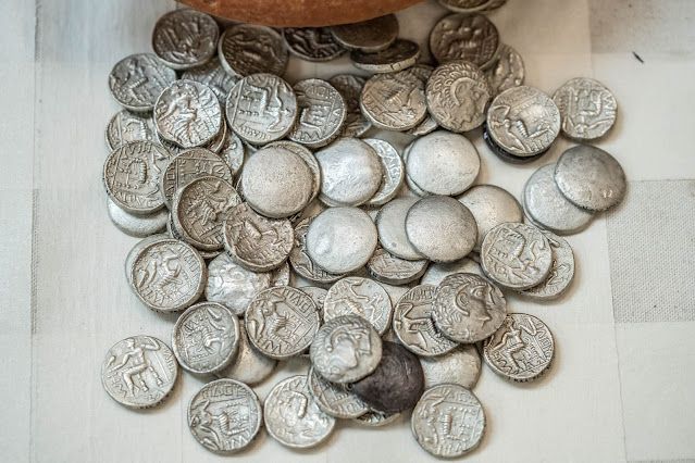 Jar filled with rare silver coins from 3rd century BC unearthed in the Emirate of Sharjah
