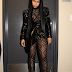 Nicki Minaj displays her curvaceous body in a black sheer bodysuit