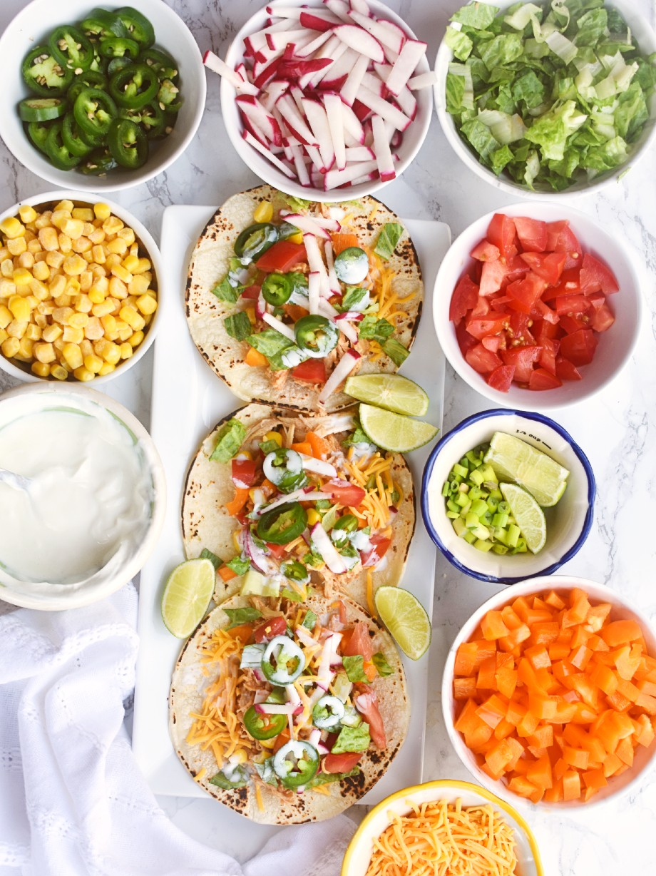 chicken taco bar with lots of toppings