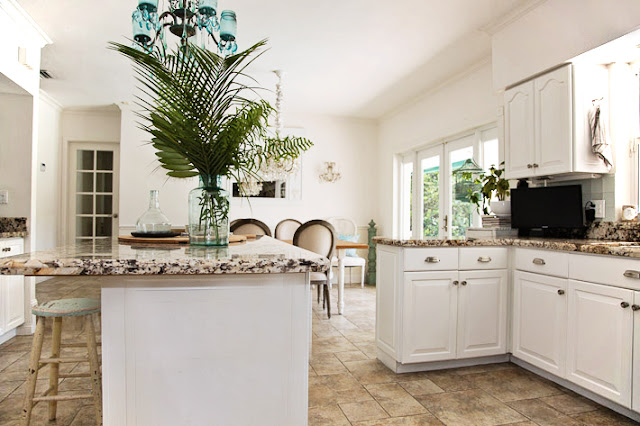 granite counters with white cabinets