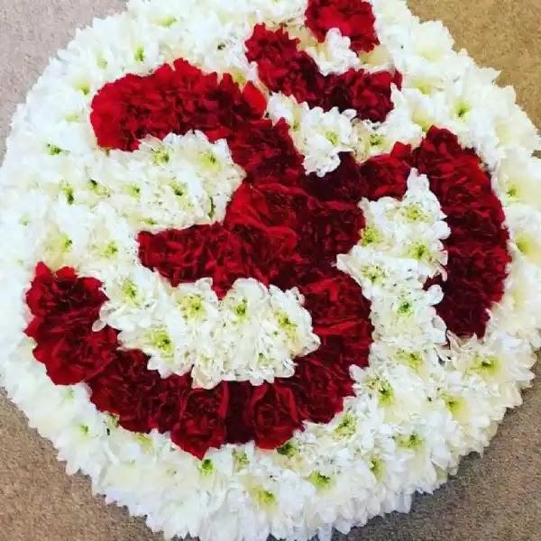 flower rangoli in the shape of om