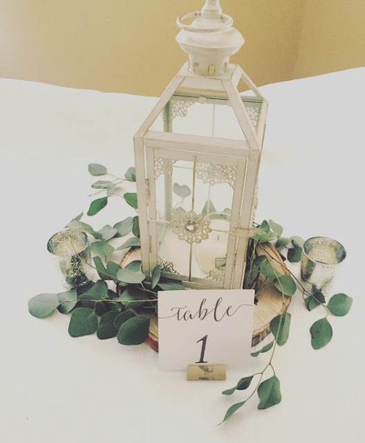 Simple lantern centerpiece decorated with eucalyptus