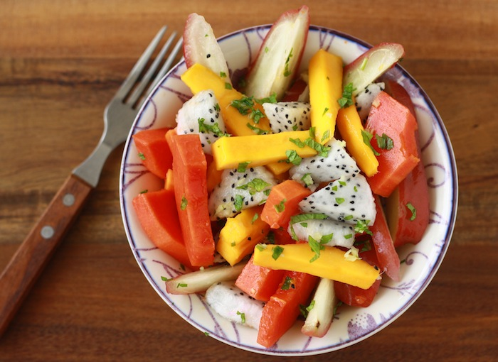 tropical fruit salad with spicy ginger mint dressing and lemon juice