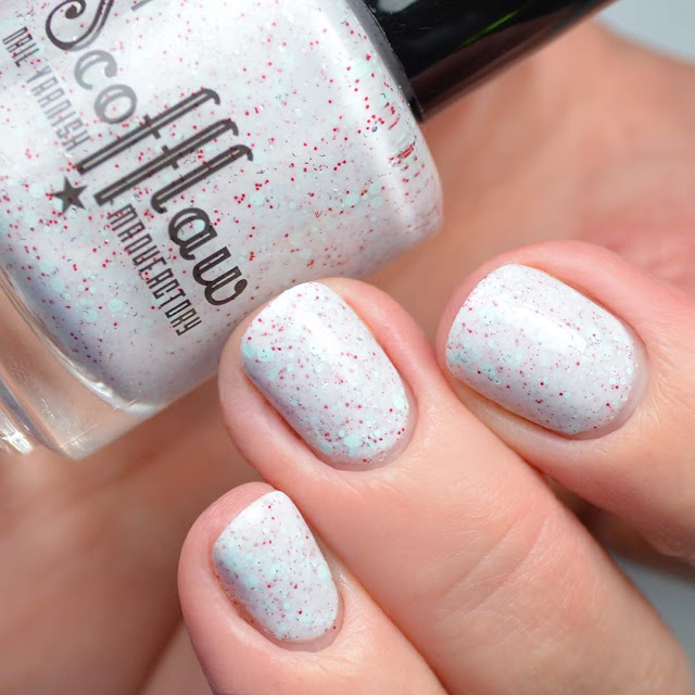 white nail polish with glitter swatch