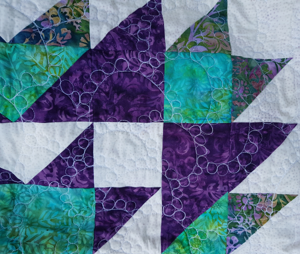 free motion quilting on Medallion Magic quilt | DevotedQuilter.com