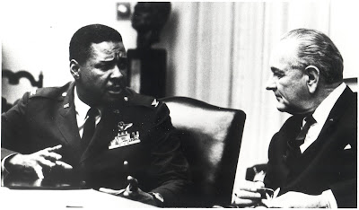 "President Lyndon B. Johnson in a discussion with Air Force Colonel Daniel ""Chappie"" James.  In 1975, James became the first African-American to achieve the rank of four-star general."