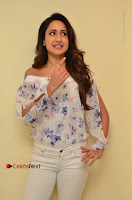 Actress Pragya Jaiswal Latest Pos in White Denim Jeans at Nakshatram Movie Teaser Launch  0003.JPG