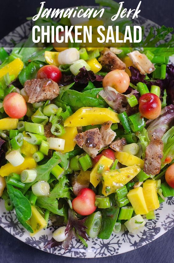 That's why this salad is so different the combination of the sweet and spicy flavors really make this salad delicious. Jamaican Jerk Chicken salad is topped with vibrant mango, rainier cherries, and spring onions on a bed of spring mix. Topped of with your favorite dressing this salad will wow. #salad #jamaicanjerk #jamaican #jamaicanfood