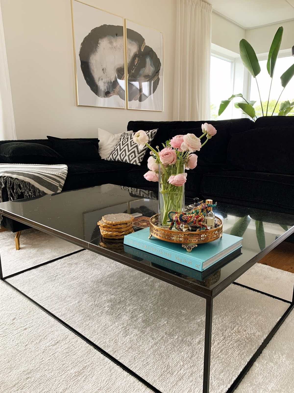 black marble table black velvet couch livingroom