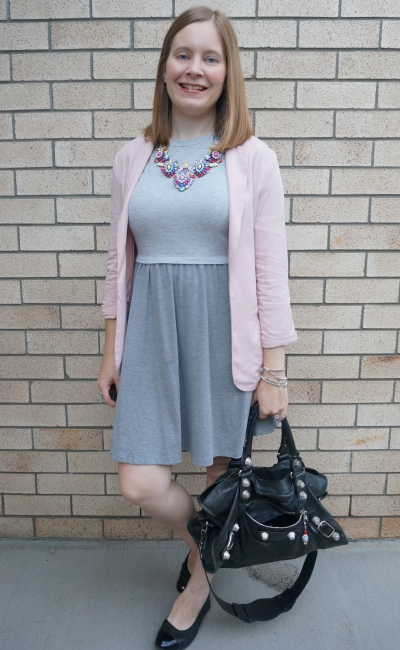 blush blazer and statement necklace with grey skater dress and black accessories Balenciaga bag | away from blue