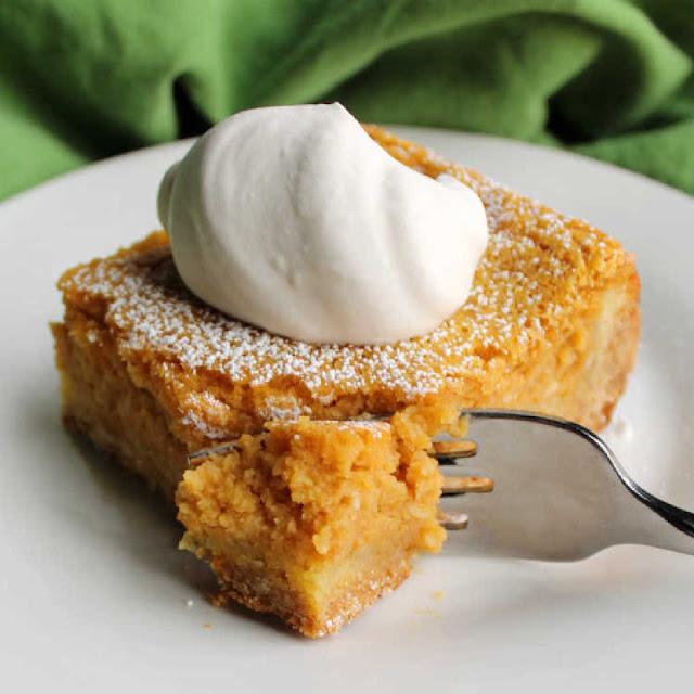 fork going in for a bite of pumpkin gooey butter cake