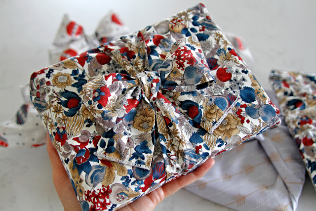 DIY dog bandana used as gift wrapping with matching fabric ribbon/bow
