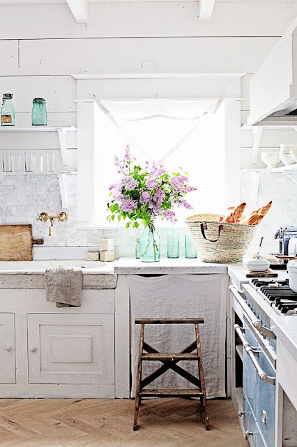 White and bright French farmhouse kitchen with market basket and flowers by Dreamywhites