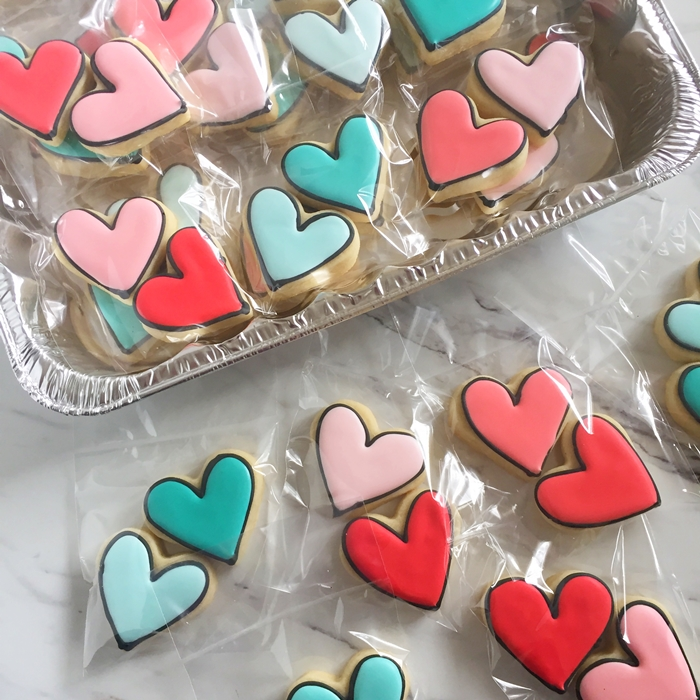 black-outlined ombre heart cookies, bagged 2x2 for a bake sale ♥ bakeat350.net