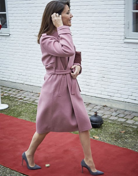 Princess Marie at DanChurchAid Christmas celebrations, wore pink coat, grey pumps, diamond ring and earrings
