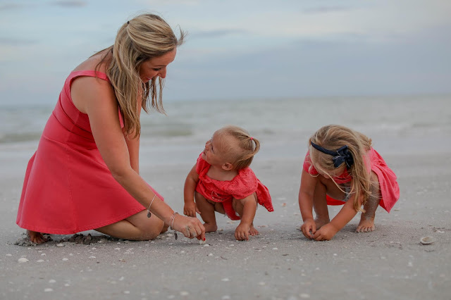 family picking shells on sanibel