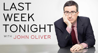An advertising poster for the comedy news show Last Week Tonight with John Oliver sitting to the right of the title text