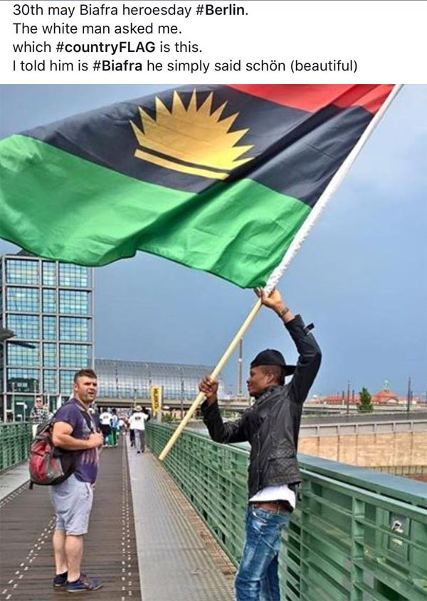 German man admires Biafran flag in Germany