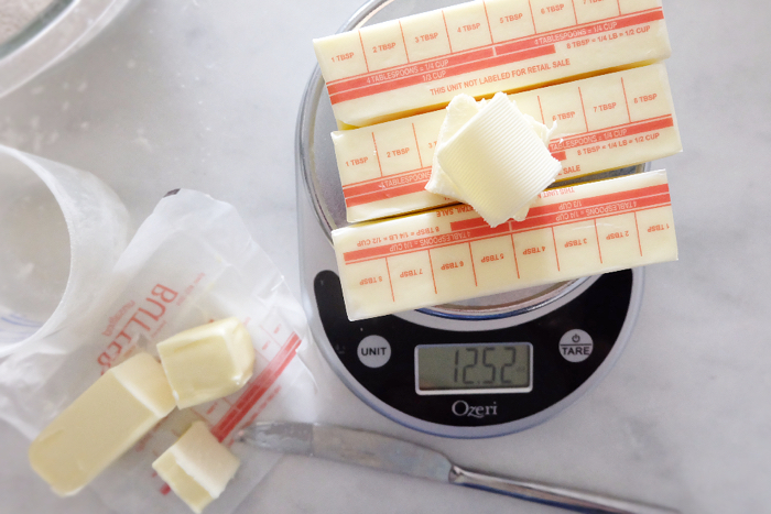weighing butter on kitchen scale