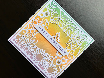 Hand made birthday card with ink blended background and die cut butterfly garden frame