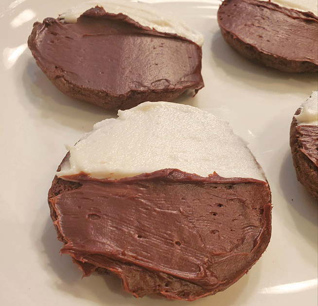 half moons make with a chocolate cake mix iced with chocolate and vanilla frosting
