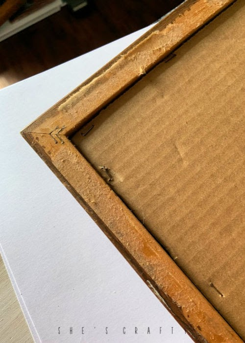 How to take apart an old framed piece of art and use the frame to make a daily checklist for kids