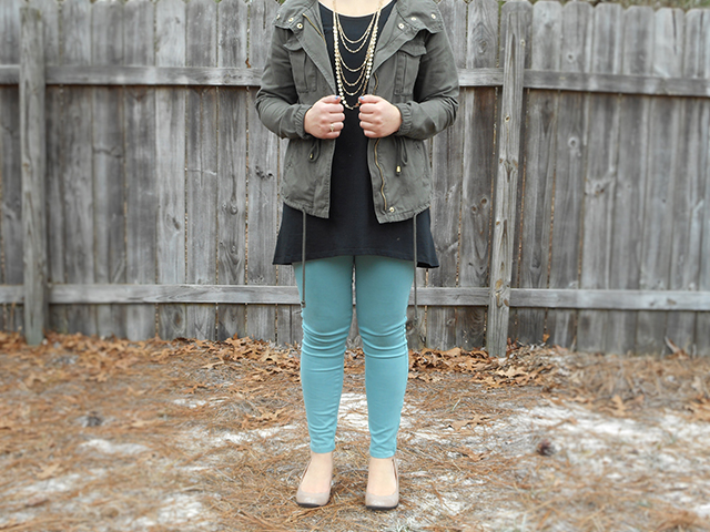 2 Bright Ways to Wear a Military Jacket for Spring black tunic turquoise skinny pants gold necklace nude heels outfit