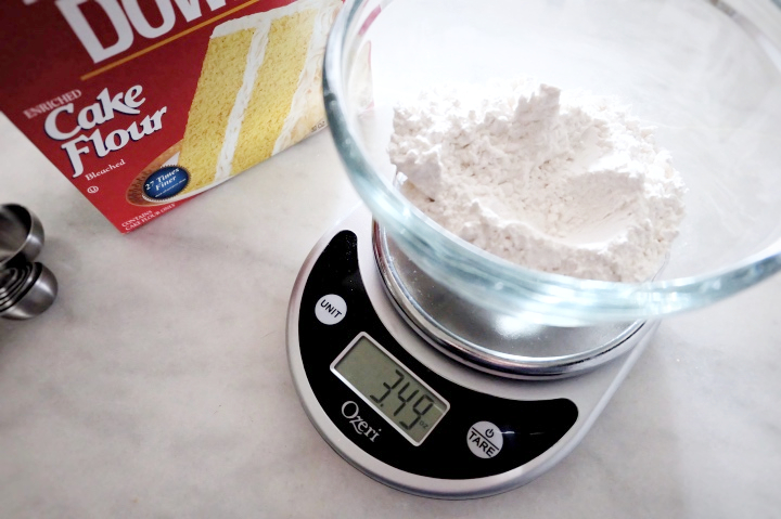 weighing cake flour on a kitchen scale