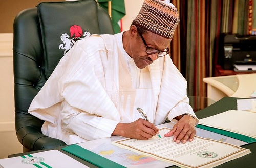 President Buhari Signs 2018 Budget... not happy with Senate, Reps