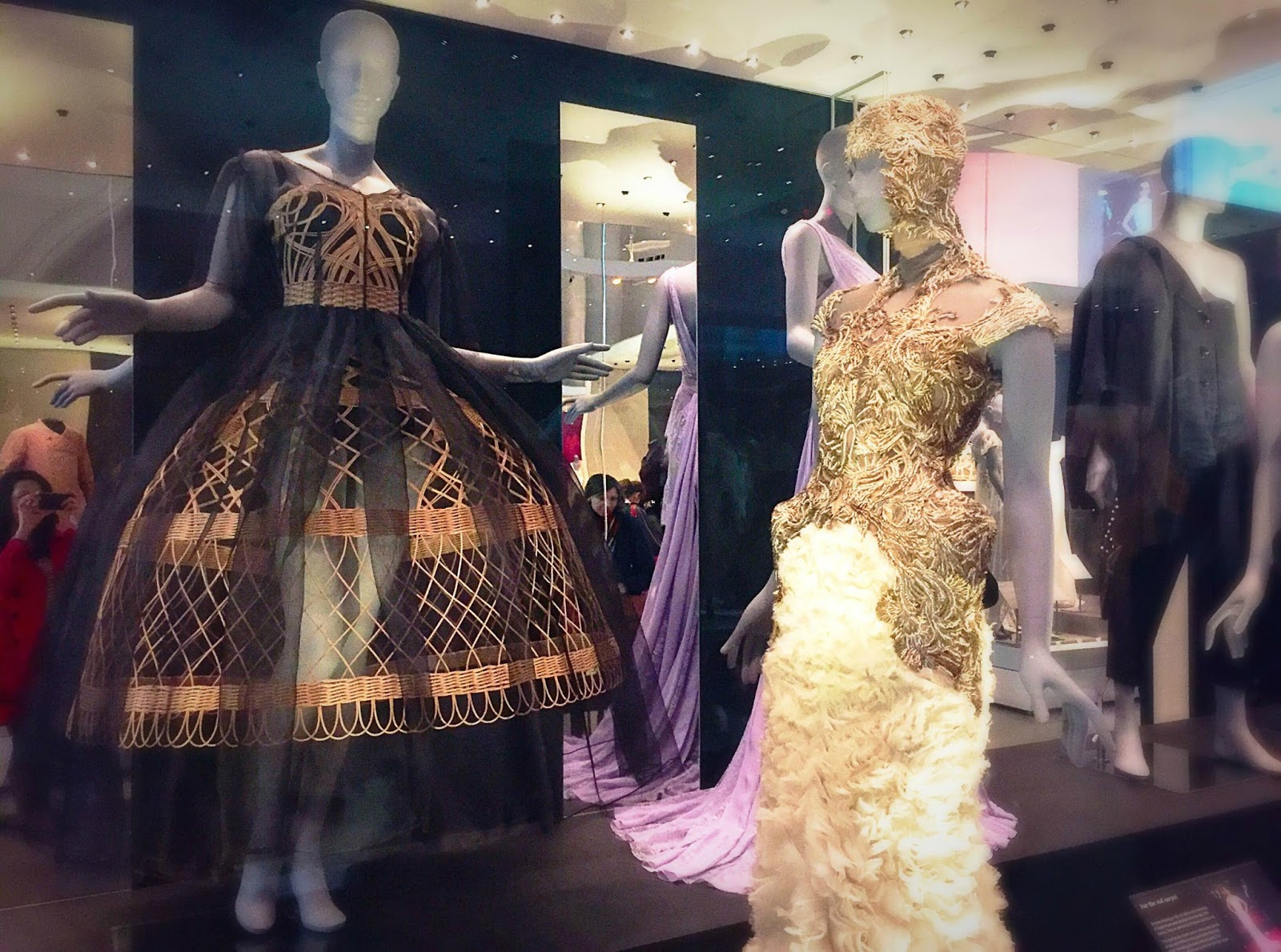 dolce and gabbana wicker dress and Alexander McQueen Feather Dress fashion exhibition